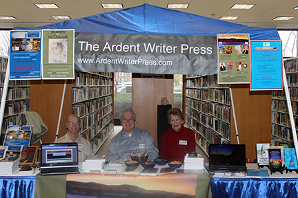 The Ardent Writer Press team sits at their booth during Birmingham Library's Local Author Expo on Saturday, Feb 2, 2013.