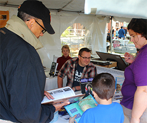 Mike Wines discusses his upcoming comedic novel, Stupid Alabama, with fans at the Alabama Book Festival in Montgomery on April 20th.  Annie Laura Smith watches in background.