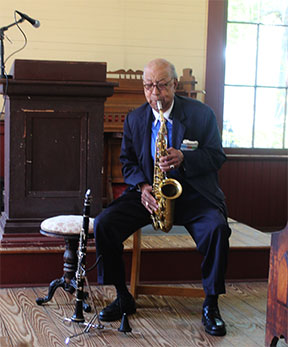 "Frank ""Doc"" Adams, Alabama Jazz Great, plays for the audience at the Alabama Book Festival."