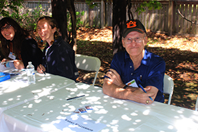 Larry Williamson awaits fans of his historical novel, Legend of the Tallassee Carbine, at the author's table during the Alabama Book Festival.