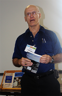 Larry Williamson discusses with fans his historical novel, Legend of the Tallassee Carbine, at the Alabama Book Festival.
