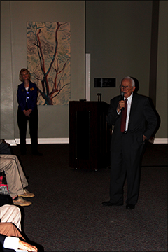 Joe takes questions from the crowd after his lecture for the Memories of World War II exhibition with the assist of Laura Smith, Huntsville Museum of Art Director for Education and the Museum Academy.
