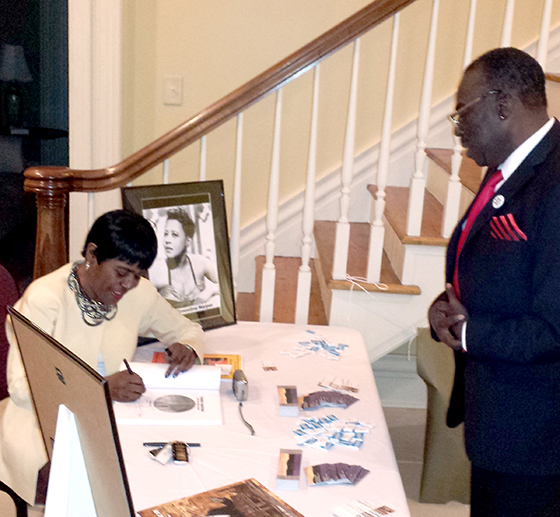 Carol Ealons, author of Tuxedo Junction-Right Back Where I Belong, signs autographs at an evening of jazz and swing at the Cooper House in Huntsville, Alabama on October 6, 2014.