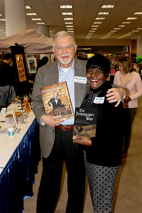 Alabama Writers' Forum Board Member Chervis Isom, Author of Newspaper Boy, swaps books with Ardent Author Carol Ealons (Tuxedo Junction)