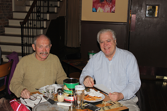 Charles Farley, author of The Hotel Monte Sano, enjoys lunch at Sam and Greggs Pizza in downtown Huntsville with publisher Steve Gierhart after signing with The Ardent Writer Press.